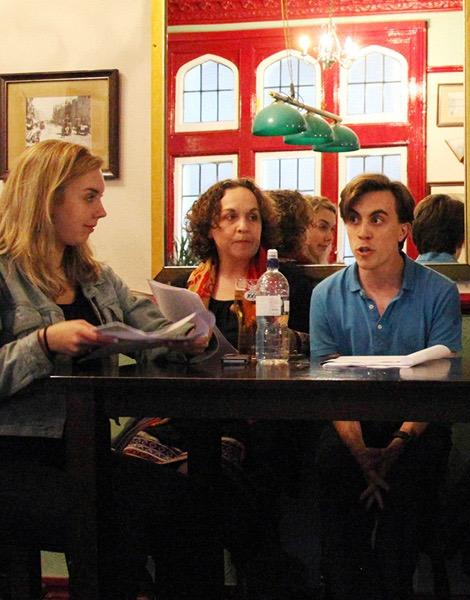 Actors performing a sitcom table read at a London Comedy Writers meeting