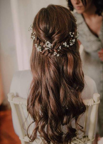 Half up half down bridal bridal hair with gypsophila flowers