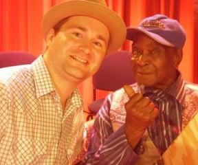 "Giving some blues folk art to David ""Honeyboy"" Edwards"