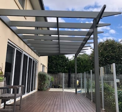 Pergola constructed from treated pine and painted to improve the decking area in Kilarney Heights