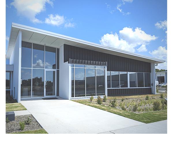 "alt=""coolum research facility glass facade metal standing seam"""