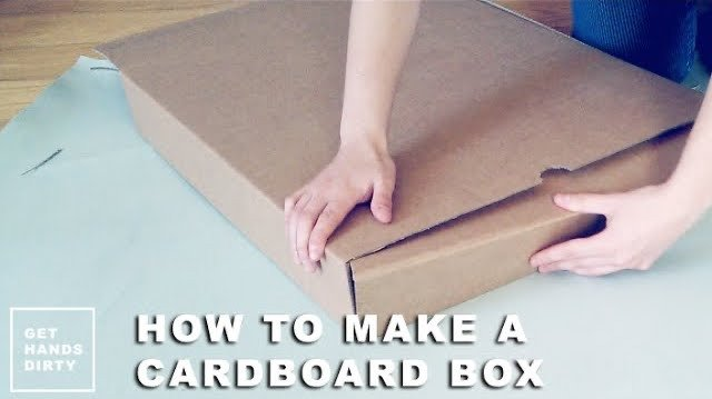 Hands assembling a handmade easy cardboard box