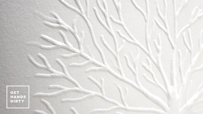 A tree illustration embossed in white thick cotton paper