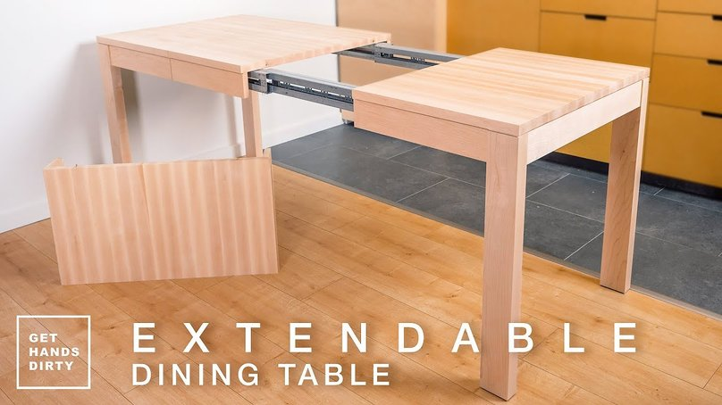 A table with its extendable parts is visible. It sits 2 or 4 people when closed and 10 when extended