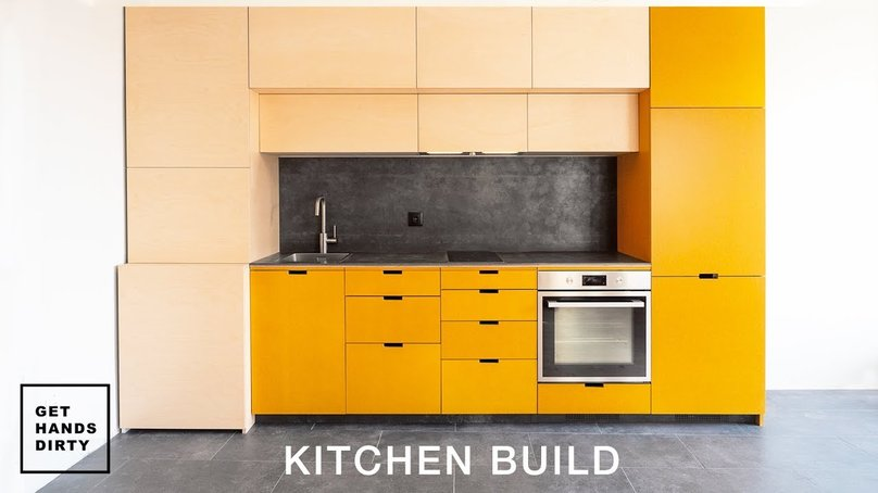 A kitchen with pine wood and colored yellow mdf.