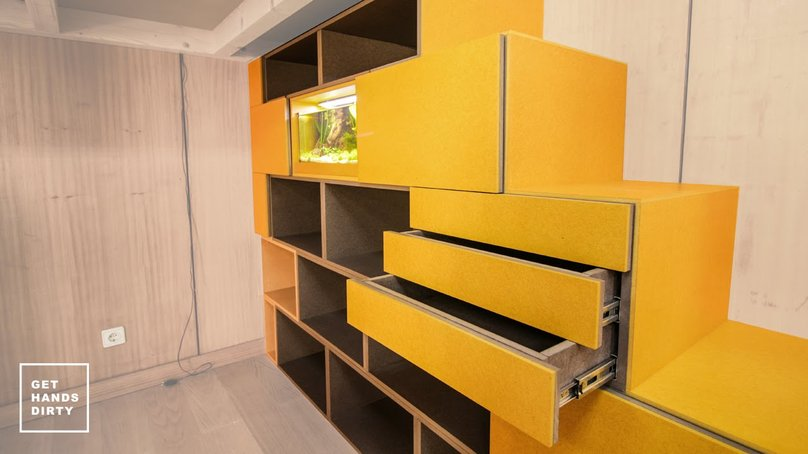 Multi-functional staircase. Built-in cabinets in the side of the stairs. All made of colored MDF.