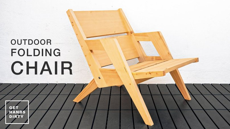 A folding chair sitting outside.