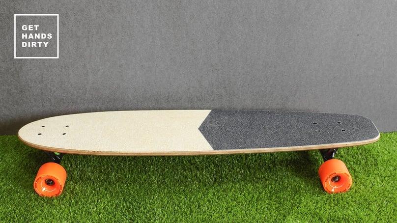 Longboard made of baltic plywood. Orange rollers.