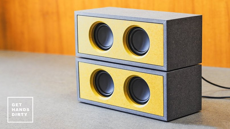 Custom speaker cases made of grey and yellow MDF.