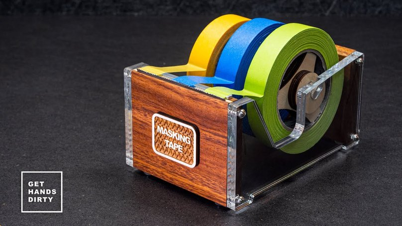 A multi roll tape dispenser made out of wood, acrylic and a bandsaw blade.